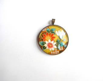 Round pendant with multicolored floral on yellow background, Japanese (washi paper + glass cabochon).