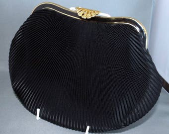 Black pleated satin evening bag with gold coloured filigree clasp