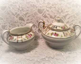 Nippon Hand-Painted Lidded Sugar Bowl and Creamer, Roses Pattern and Gold Trim, Rising Sun Logo, 1890 to 1921.