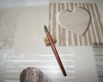 Pen is turned by hand in wood violet