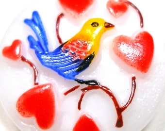 """LoveBIRD Button, Czech glass with hearts & bird in blue, yellow 7/8"""" 22mm."""