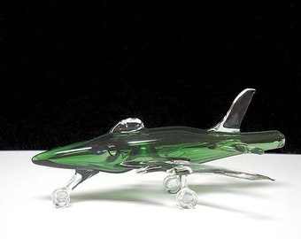 Hand blown glass jet airplane pipe.