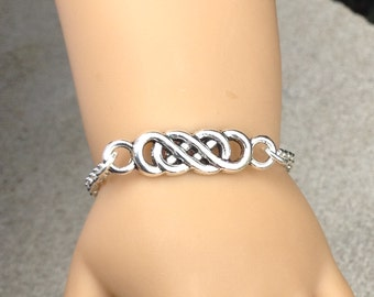 "My doll and me matching Celtic infinity symbol silver plated bracelets for girls and their American Girl doll and/or other 18"" dolls"