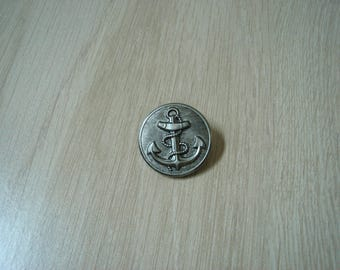 silver metal button with anchor