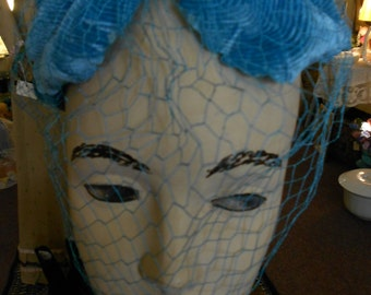 """1950's, 22"""", turquoise blue velvet leaf shaped small hat fitting over crown of the head."""
