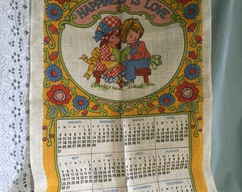 Five country-style 1980s linen tea towels