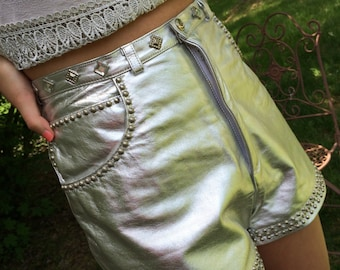 Outrageous silver leather hot pants studded with silver and rhinestones. vintage shorts, leather shorts, silver shorts, studded leather