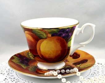 Duchess Teacup & Saucer, Fruit Orchard Pattern, Gold Rims, Bone English China made in 1970s