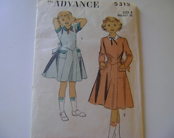 Vintage Advance Child's Short Sleeve Dress Pattern 5315  with Contrasting Collar, Pocket Flaps and Cuffs