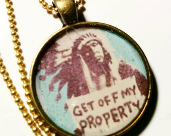 Get off my property, Indian protest art.  Bronze pendant with 24 inch ball chain.