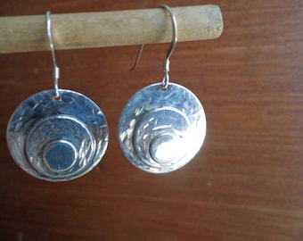 Silver disk earrings.