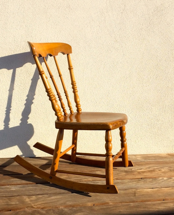 Like this item? - Antique Child's Rocking Chair Wooden Armless Rocker