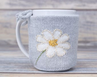 Mug sweater, Tea sleeve,  Cup warmer, Flower lover gift, Knitted coffee mug cozy, Party favor,  White flower,  Hot drink cozy, Floral design