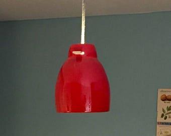 Suspension red glazed earthenware