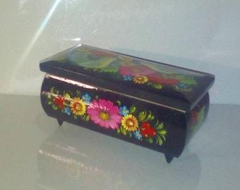 The box is Ukrainian. Petrikov painting.