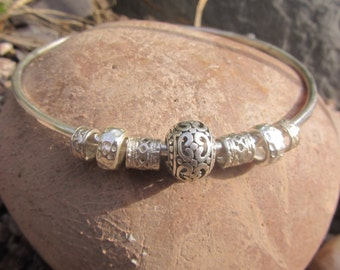 Beautiful solid silver bangle with silver charm beads
