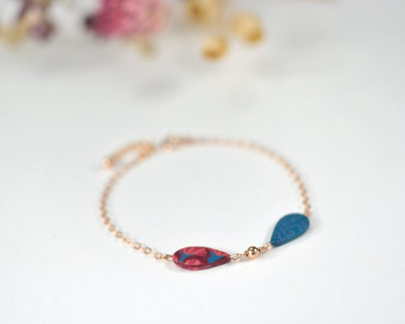 Rose gold filled bracelet with burgundy and blue patterned leaves