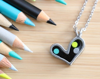 Colored pencils recycled into heart shaped pendant, pewter and resin