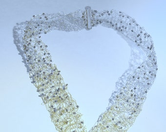 Handcrafted and Stunning  crochet wire necklace in  silver wire.