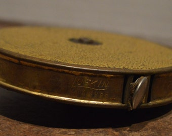 Vintage Lufkin Brass Case 75 foot Cloth Tape Measure