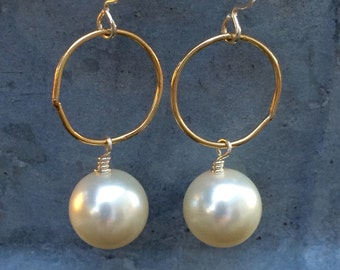 """the """"sophie"""" soft white swarovski pearls affixed to gold-filled link and sterling loop earwire"""