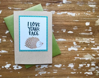 Love Your Face Hedgehog card in gold and slate