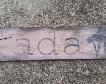 Distressed wooden name plaque