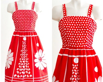 Red sleeveless fit and flare dress with white flower pattern