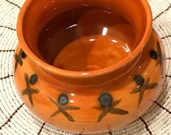 X and O red ceramic pot