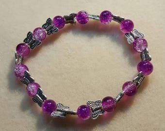 Purple butterfly bracelet.
