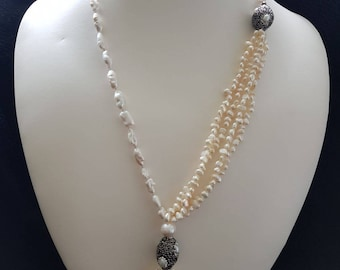 Freshwater pearl with marquasite and rhinestone  beads and fresh water pearl tassel. Lenght 17""