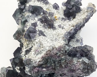 Cluster of Purple to Dark Green Cubic Fluorite Crystals on Matrix of Tiny Quartz from Mexico