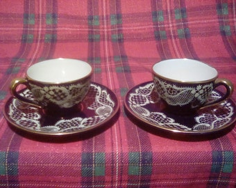 Two tea cups with saucers