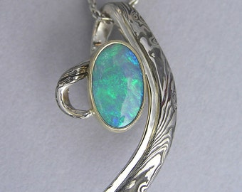 Opal pendant in Mokume and 18 kt gold