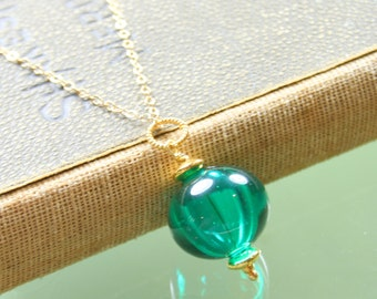 teal hollow lampwork glass bead pendant on gold filled chain necklace