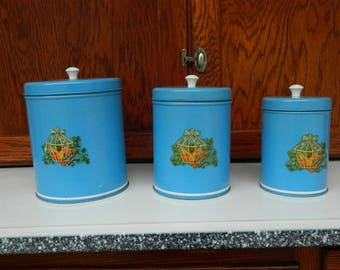 Set of 3 Sky Blue Kitchen Canisters with decals and plastic knobs vintage 1940's