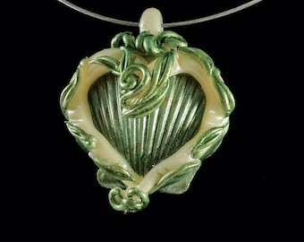 Scallop shell polymer clay pendant - scallop shell with ivory colored polymer clay heart and pearl green leaves - mothers day gift