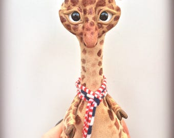 Giraffe. African animal. Beige soft plush clay toy, moveable doll