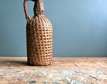 A vintage French bottle in a woven basket, country kitchen, kitchen decor