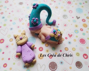 baby girl known cat polymer clay.