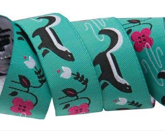 Renaissance Ribbons Jacquard Black Skunk on Turquoise Jessica Jones JO 31 22 Price is for 1 yard.