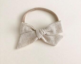 oversized schoolgirl bow  | natural linen