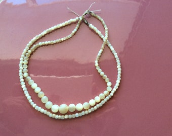Two antique shell bead necklaces mother of pearl