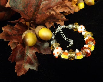 Candy Corn Halloween European Style Bracelet with Enameled Metal Charms and Glass Lampwork Beads in Orange, Yellow and White