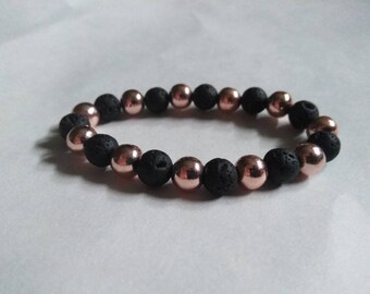 Lava stone diffuser bracelet with rose gold plated hematite.
