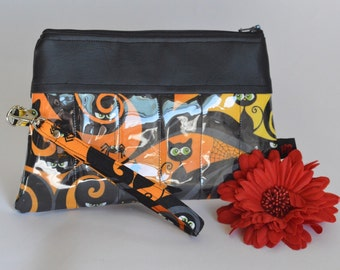 Zippered wristlet wallet in a black cat and haunted house fabric (Great Halloween bag)