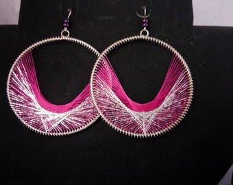 A pair of earrings hoops fuchia