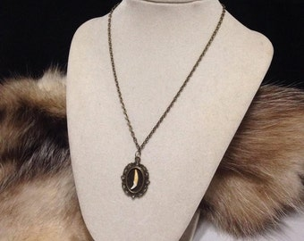 Mink tooth cameo necklace