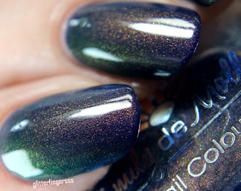 "Nail polish - ""Midnight Serenade"" A dark blue with pink/gold/green multichrome shimmer"