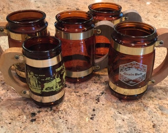 Lot of Five Amber Glass Barrel Mugs with Wooden Handle & Brass Hardware-Including One Grain Belt Beer and Two Knotts Berry Farm
